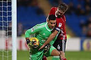 Luke Chambers, the Ipswich Town captain ® attempts to get the ball off Cardiff city goalkeeper Neil Etheridge. EFL Skybet championship match, Cardiff city v Ipswich Town at the Cardiff city stadium in Cardiff, South Wales on Tuesday 31st October 2017.<br /> pic by Andrew Orchard, Andrew Orchard sports photography.