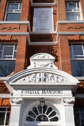 An exterior of Carlyle Mansions on Cheyne Walk in Chelsea, on 8th March 2021, in London, England. Carlyle Mansions is a block of flats located on Cheyne Walk, in the Chelsea area of London, England. Built in 1886, it was named after Scottish historian, satirical writer, essayist, translator, philosopher, mathematician, and teacher, Thomas Carlyle, himself a resident of Chelsea for much of his life. Carlyle Mansions is nicknamed the Writers' Block, as it has been home to Henry James, Erskine Childers, T. S. Eliot, Somerset Maugham, Ian Fleming and other noted authors.