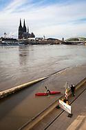 flood of the Rhine on February 4th. 2021, view from the flooded bank of the Rhine in Deutz to the Cathedral, Cologne, Germany.<br /> <br /> Hochwasser des Rheins am 4. Februar 2021, Blick vom ueberfluteten Rheinufer in Deutz zum  Dom, Koeln, Deutschland.
