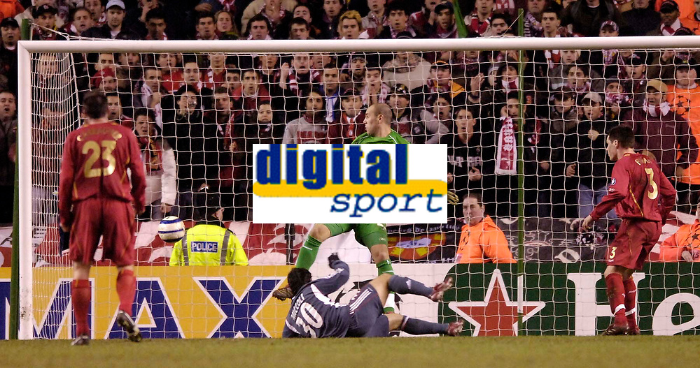 Photo: Jed Wee.<br /> Liverpool v Benfica. UEFA Champions League. 08/03/2006.<br /> <br /> Benfica's Fabrizio Miccoli ends the contest as he pokes the ball past Liverpool goalkeeper Jose Reina.