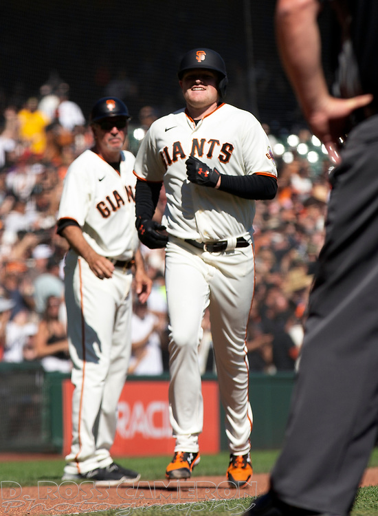 Oct 3, 2021; San Francisco, California, USA; San Francisco Giants starting pitcher Logan Webb (62) runs out his two-run home run against the San Diego Padres during the sixth inning at Oracle Park. Mandatory Credit: D. Ross Cameron-USA TODAY Sports