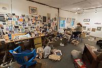 Fly fishing guide, artist and Patagonia Ambassador, Rachel Finn at work in her art studio in Wilmington, New York