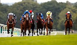Rum Runner (centre, blue and yellow cap) ridden by Pat Dobbs on the way to winning The Randox Handicap during Randox Health Gentlemen's Day at Sandown Park Racecourse, Esher.