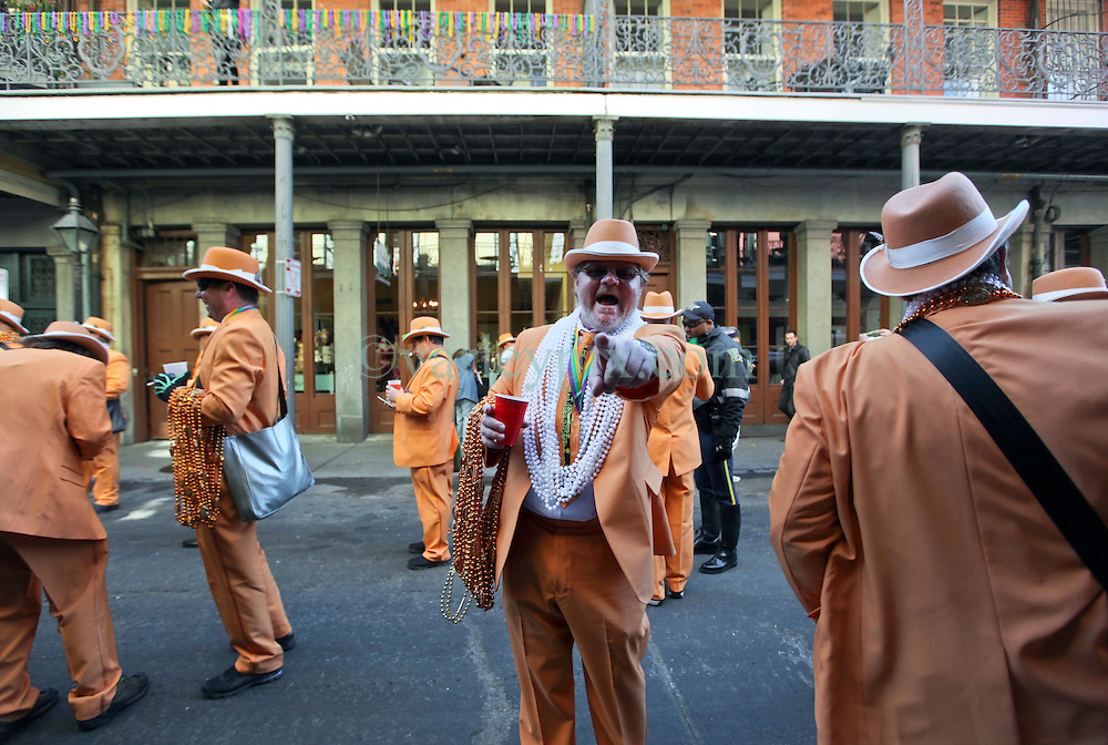 09 February 2016. New Orleans, Louisiana.<br /> Mardi Gras Day. Members of the Pete Fountain Half-Fast Walking Club in the French Quarter. <br /> Photo©; Charlie Varley/varleypix.com