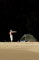 Alicia Ritter doing yoga while camping on a secluded beach in Ecola State Park along the Oregon Coast. Cannon Beach, OR<br />