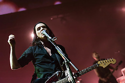 © Licensed to London News Pictures. 16/12/2013. London, UK.   Placebo performing live at Brixton Academy. In this picture - Brian Molko (left), Stefan Olsdal (right).  Placebo are an English alternative rock band, formed in London in 1994, consisting of members Brian Molko (lead vocals/guitars), Stefan Olsdal (vocals/bass), Steve Forrest (drums/vocals).  The band is touring to support its seventh studio album 'Loud Like Love'. Photo credit : Richard Isaac/LNP