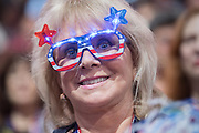 A GOP delegate wears patriotic glasses during the third day of the Republican National Convention July 20, 2016 in Cleveland, Ohio.