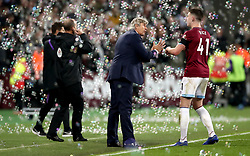 West Ham United manager Manuel Pellegrini speaks to Declan Rice as bubbles are blown on to the pitch during the Carabao Cup, Fourth Round match at the London Stadium.