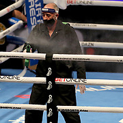 Disinfectant spray is used to clean the ring between bouts during the undercard fight at the Gennady Golovkin versus Kamil Szeremeta world title fight at the Seminole Hard Rock Hotel and Casino in Hollywood, Florida USA on 18, Dec 2020. Photo: Alex Menendez