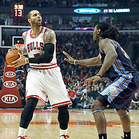 26 March 2012: Chicago Bulls power forward Carlos Boozer (5) looks to pass the ball during the Denver Nuggets 108-91 victory over the Chicago Bulls at the United Center, Chicago, Illinois, USA. NOTE TO USER: User expressly acknowledges and agrees that, by downloading and or using this photograph, User is consenting to the terms and conditions of the Getty Images License Agreement. Mandatory Credit: 2012 NBAE (Photo by Chris Elise/NBAE via Getty Images)