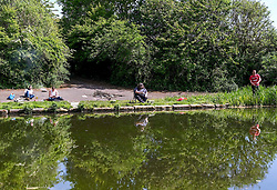 Men Fishing in Forth Canal During Lockdown, Edinburgh, 20 May 2020<br /> <br /> Pictured: Four men were spotted fishing in the Forth Canal in Edinburgh on the hottest day of the year so far. They were also drinking beer and having a barbecue despite those activities being banned under lockdown rules.<br /> <br /> Alex Todd | Edinburgh Elite Media