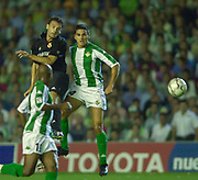 Photo Peter Spurrier<br /> 14/09/2002<br /> Spanish Premier League Football<br /> Real Betis vs Real Madrid<br /> Madrid's, Fernando Morientes Sánchez, directs the ball into the box outjumping,  Betis's, Juanito Gutiérrez,
