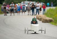Brady Palmer in #27 focuses on the finish line during one of his heats in the 2nd annual Franklin Elks Soap Box Derby Saturday morning.  (Karen Bobotas/for the Laconia Daily Sun)