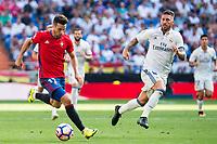 Real Madrid's player Sergio Ramos and Osasuna player Jaime Romero Gomez during a match of La Liga Santander at Santiago Bernabeu Stadium in Madrid. September 10, Spain. 2016. (ALTERPHOTOS/BorjaB.Hojas)