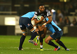 Lukhanyo Am of the Sharks is tackled during the Currie Cup match between the The Sharks and The Blue Bulls held at King's Park, Durban, South Africa on the 27th August 2016<br /> <br /> Photo by:   Anesh Debiky / Real Time Images