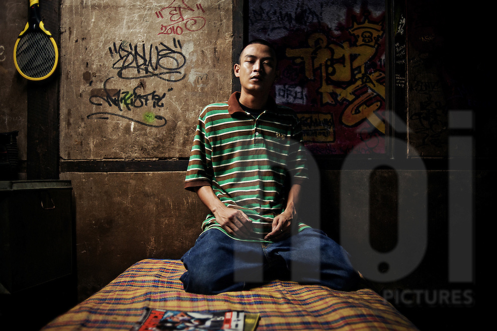 Rapper and graffiti artist Thuta 'Aye' Ill, founder of the hip-hop group Cyclone and graffiti crew YSA, here in his house in Kyi Myint Daing district, Yangon.