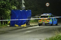 © Licensed to London News Pictures. 08/10/2021. Oxford, UK. A forensic privacy barrier next to a Thames Valley Police car at the crime scene in Bayswater Road, Barton in Oxfordshire. Police were called just before 6:00pm today, Friday 08/10/2021, to reports of a man being stabbed, the victim, a man aged in his thirties, died of his injuries at the scene. Photo credit: Peter Manning/LNP