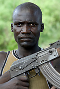 Young man with gun AK47, Mursi Tribe, Mago National Park, Lower Omo Valley, Ethiopia, portrait, person, one, tribes, tribal, indigenous, peoples, Southern, ethnic, rural, local, traditional, culture, primitive, Rifle, Weapon, Assault, Kalashnikov