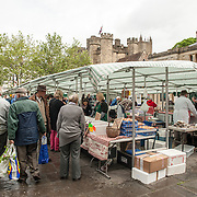 Shoppers at a street market in Market Place in downtown Wells, Somerset, near Wells Cathedral.