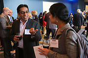 Krish Prasad of VMware, Inc. talks with others during the Silicon Valley Business Journal's Women of Influence event at the Fairmont San Jose in San Jose, California, on May 16, 2019. (Stan Olszewski for Silicon Valley Business Journal)