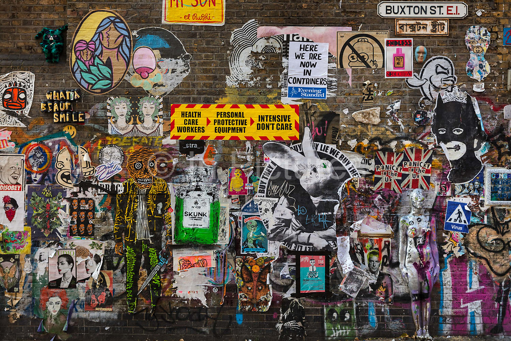 NHS support mural in amongst the graffitti and posters on a wall in Brick Lane during the coronavirus pandemic on the 24th April 2020 in London, United Kingdom.