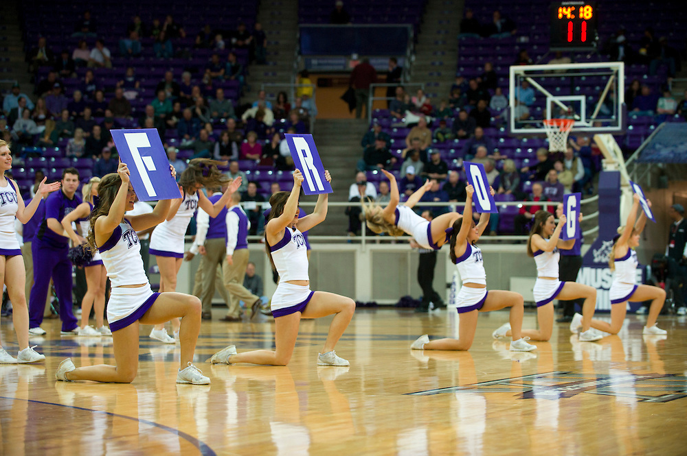 FORT WORTH, TX - JANUARY 7: TCU cheerleaders perform during a timeout against the Kansas State Wildcats on January 7, 2014 at Daniel-Meyer Coliseum in Fort Worth, Texas.  (Photo by Cooper Neill/Getty Images) *** Local Caption ***