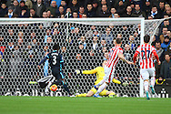 Marko Arnautovic of Stoke City slots the ball home and scores his teams 2nd goal. Barclays Premier league match, Stoke city v Manchester city at the Britannia Stadium in Stoke on Trent, Staffs on Saturday 5th December 2015.<br /> pic by Chris Stading, Andrew Orchard sports photography.