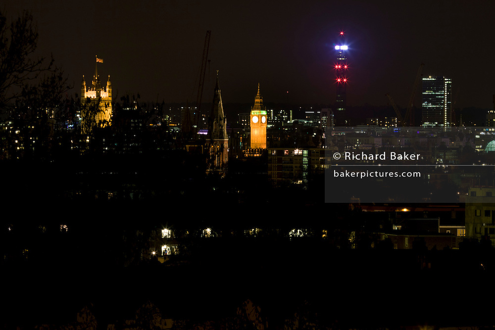 Looking from south London towards Big Ben,  parliament and BT Tower through the darkenss of the suburbs.