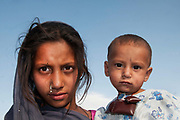 Afghanistan. Ferisha aged 11 with brother Mamadullah , Charahi Spinkali, district 5, Kabul.