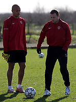 Photo: Paul Thomas.<br />Manchester United training session. UEFA Champions League. 06/03/2007.<br />Man Utd's Wes Brown (L) and Wayne Rooney (R) during training.