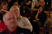 Kari Malkovich, right, listens disconcertedly to Mitt Romney's concession speech at the Utah Republican Party results party, Tuesday, Nov. 6, 2012.