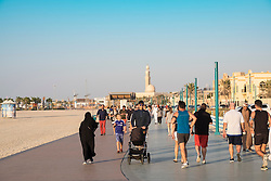 Many people using new public boardwalk and jogging track beside beach   in Dubai United Arab Emirates