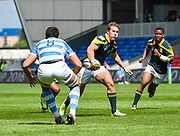 South Africa centre Franco Naude side-steps Argentina No.8 Facundo Nahuel Dominguez during the World Rugby U20 Championship 3rd Place play-off  match Argentina U20 -V- South Africa U20 at The AJ Bell Stadium, Salford, Greater Manchester, England on Saturday, June 25, 2016.(Steve Flynn/Image of Sport)