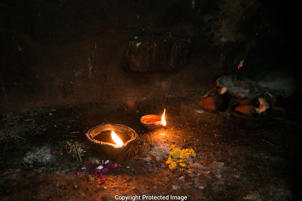 Small oil lamps flicker in the darkness are offerings to the Djinn