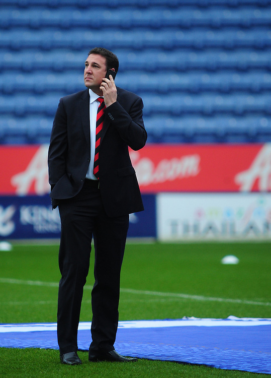 Cardiff City's Manager Malky Mackay talks on his mobile phone in the middle of the pitch at Leicester City's King Power Stadium before kick off..Football - npower Football League Championship - Leicester City v Cardiff City - Saturday 22nd December 2012 - The King Power Stadium - Leicester..© CameraSport - 43 Linden Ave. Countesthorpe. Leicester. England. LE8 5PG - Tel: +44 (0) 116 277 4147 - admin@camerasport.com - www.camerasport.com