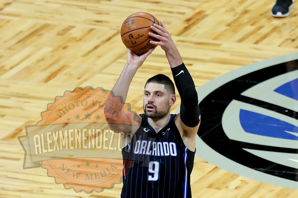 ORLANDO, FL - MARCH 03: Nikola Vucevic #9 of the Orlando Magic shoots the ball against the Atlanta Hawks at Amway Center on March 3, 2021 in Orlando, Florida. NOTE TO USER: User expressly acknowledges and agrees that, by downloading and or using this photograph, User is consenting to the terms and conditions of the Getty Images License Agreement. (Photo by Alex Menendez/Getty Images)*** Local Caption *** Nikola Vucevic