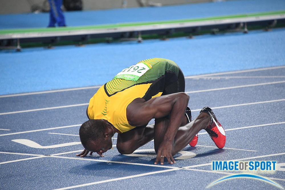 Aug 18, 2016; Rio de Janeiro, Brazil; Usain Bolt (JAM) kisses the track after winning the 200m in 19.78 during the 2016 Rio Olympics at Estadio Olimpico Joao Havelange.