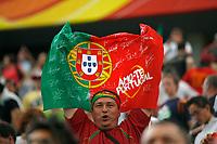 Photo: Glyn Thomas.<br />Portugal v Iran. Group D, FIFA World Cup 2006. 17/06/2006.<br /> A Portugal fan celebrates.
