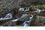 20x30 poster print of a seasonal cascade of water in the mountains.