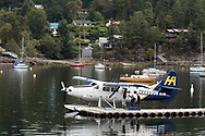 Passengers board a Harbour Air Seaplane (DHC-3 Turbine Single Otter) in Ganges Harbour on Salt Spring Island, British Columbia, Canada.