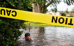 September 11, 2017 - Belle Glade, Florida, U.S. - Palm Beach County Public works employee FELIX RIVEIRA works on fixing a broken water main adding to the flooding at SE 6th Drive. (Credit Image: © Allen Eyestone/The Palm Beach Post via ZUMA Wire)