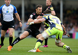 Exeter Chiefs' Nic White (centre) takes on Sale Sharks' Tom Curry (right) during the Aviva Premiership match at Sandy Park, Exeter. PRESS ASSOCIATION Photo. Picture date: Saturday April 28, 2018. See PA story RUGBYU Exeter. Photo credit should read: Mark Kerton/PA Wire. RESTRICTIONS: Editorial use only. No commercial use.