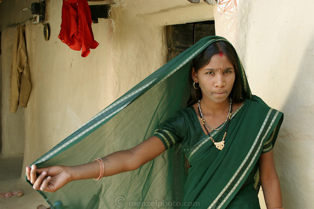 IND.MWdrv04.355.x..Bachau and Mishri Yadav's oldest child, daughter Nishadevi, 19, called Guddi, is betrothed by family arrangement to a boy living in a village 30 km from her home village of Ahraura Village, Uttar Pradesh, India. Revisit with the family, 2004. The Yadavs were India's participants in Material World: A Global Family Portrait, 1994 (pages: 64-65), for which they took all of their possessions out of their house for a family-and-possessions-portrait. Children, Child, Marriage..