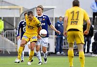 Fotball , 23. August 2009<br /> Tippeligaen<br /> Bodø/Glimt - Viking<br /> Christian Berg og Mounir Hamoud , Bodø/Glimt<br /> Birkir Bjarnason , Viking<br /> Foto: Tor-Erik Eidissen , Digitalsport