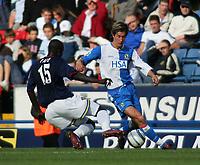 Photo. Andrew Unwin.Digitalsport<br /> Blackburn Rovers v Portsmouth, Barclays Premiership, Ewood Park, Blackburn 18/09/2004.<br /> Portsmouth's Andy Faye (L) looks to tackles Blackburn's Morten Gamst Pedersen (R).