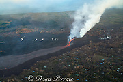 lava erupting from fissure 8 of the Kilauea Volcano east rift zone in Leilani Estates residential subdivision, near Pahoa, pours out of its cinder cone and flows downslope as a river of hot lava toward Kapoho, lower Puna District, Hawaii Island ( the Big Island ), Hawaiian Islands, U.S.A. ( Pacific Ocean )
