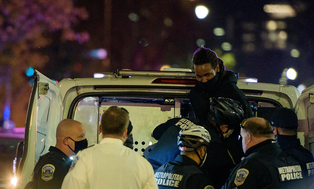 A protester is detained at Black Lives Matter Plaza in Washington DC, November 3, 2020.