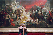 """Saint Petersburg, Russia, June 2002..The Russian Museum, with its extensive collection of Russian art, is one of the city's many world-class museums. Two visitors study Bryullov's """"The Last Days Of Pompeii"""".."""