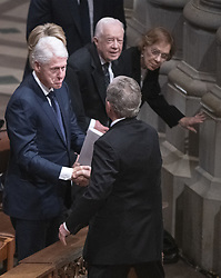 Former United States President George W. Bush shakes hands with former United States President Bill Clinton as he arrives for the National funeral service in honor of the late former US President George H.W. Bush at the Washington National Cathedral in Washington, DC on Wednesday, December 5, 2018. Looking on from the right are former United States President Jimmy Carter and former first lady Rosalynn Carter.<br /> Photo by Ron Sachs / CNP/ABACAPRESS.COM