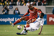 Real Salt Lake defender Jamison Olave, top, is fouled by Los Angeles Galaxy forward Edson Buddle during the first half of an MLS soccer match, Saturday, March 10, 2012, in Carson, Calif. (AP Photo/Bret Hartman)